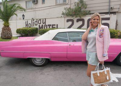 Pink Cadillac at Las Vegas Strip Wedding Chapel at Holiday Motel Las Vegas Best Travel Blog Blogger Christi Tasker wearing Banana Republic pink jacket Ralph Lauren cork purse handbag