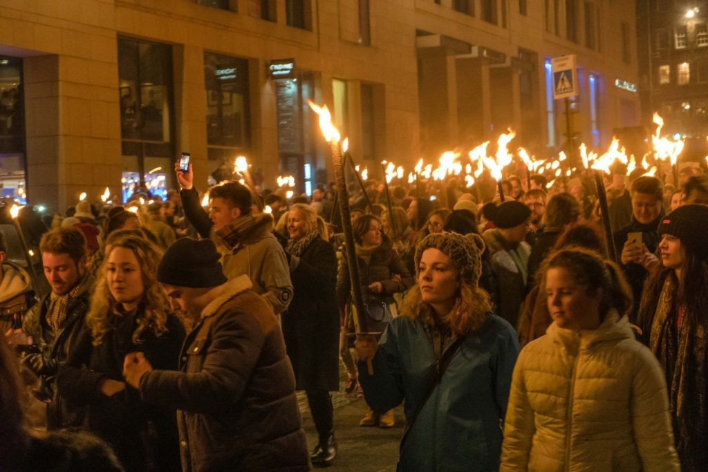 Hogmanay procession of torches scotla, Edinburgh Scotland is on fire for New Year's Eve Hogmanay Festivities